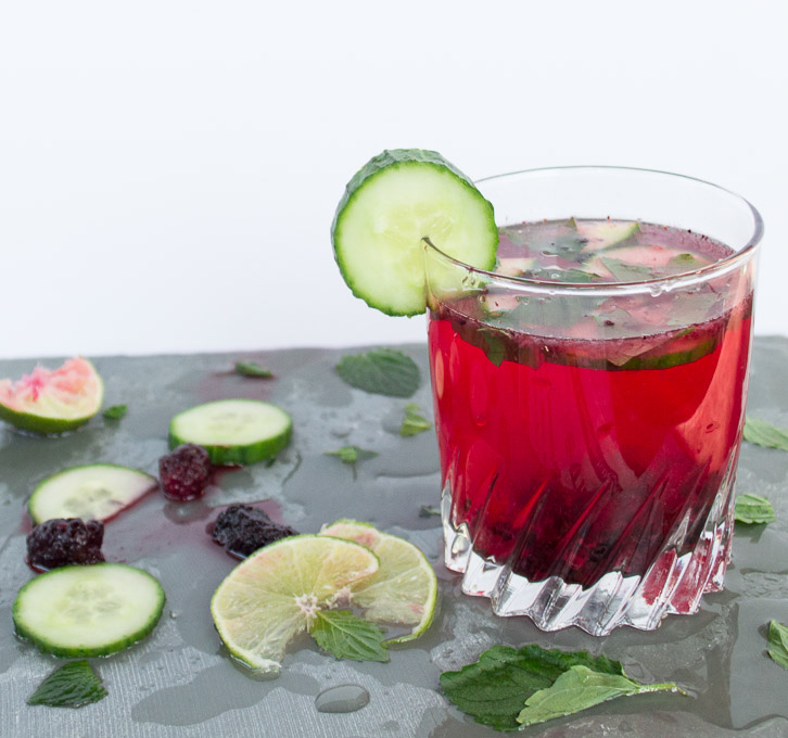 blackberry cucumber mojito with sliced cucumbers, limes, mint