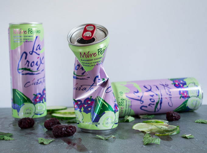 LaCroix bottles smashed with ice, limes, cucumbers