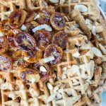 oatmeal waffles topped with bananas foster