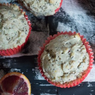 bird's eye view of blood orange chia seed muffins in red muffin liners