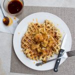 rosemary waffles with chicken and cauliflower and hot sauce