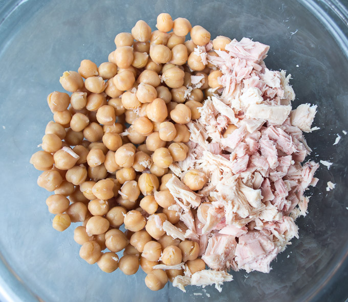 mix of tuna and chickpeas in glass bowl