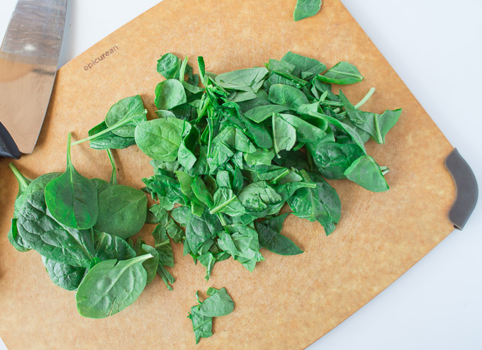 chopped spinach on cutting board
