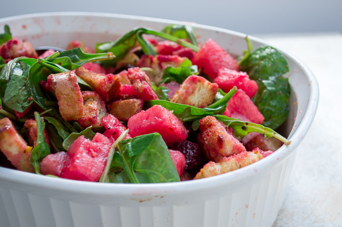 beet panzanella salad in a white ceramic dish