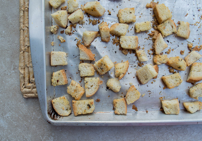 homemade croutons on baking sheet