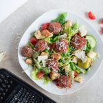 Meatball salad in a white bowl