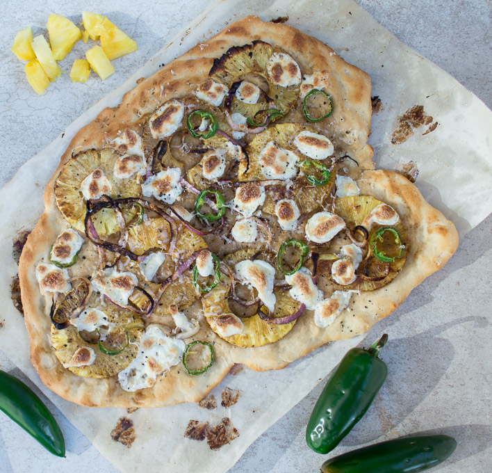 pineapple pizza with cut pineapple and jalapenos