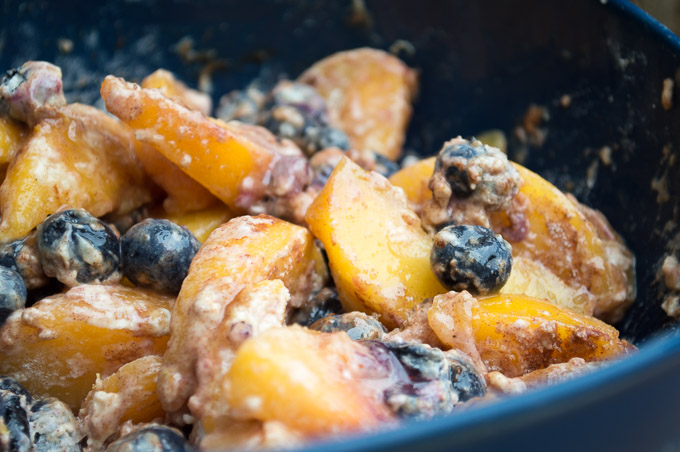 close view of cinnamon coated peaches and blueberries