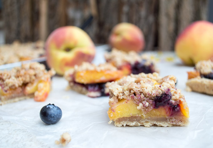 sliced peach blueberry slab pie