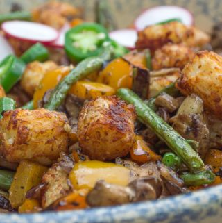 side view of grilled veggies with tots