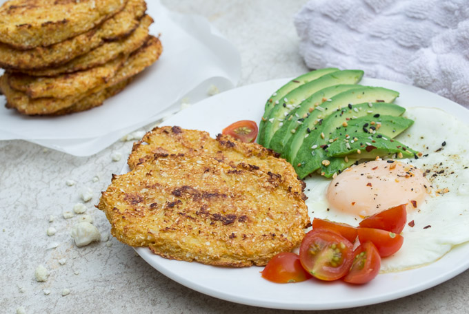 cauliflower hash brown breakfast with pile of hash browns