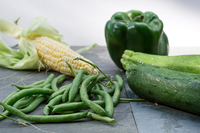 summer produce - corn, green beans, zucchini, bell pepper