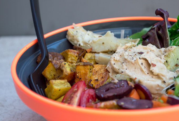 Showing the potatoes and hummus in veggie bowl