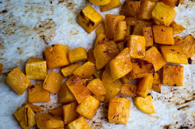 roasted butternut squash on parchment paper