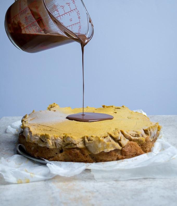 drizzling magic shell on pumpkin coconut ice cream cake