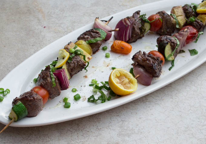 veggie and meat kebabs on white plate