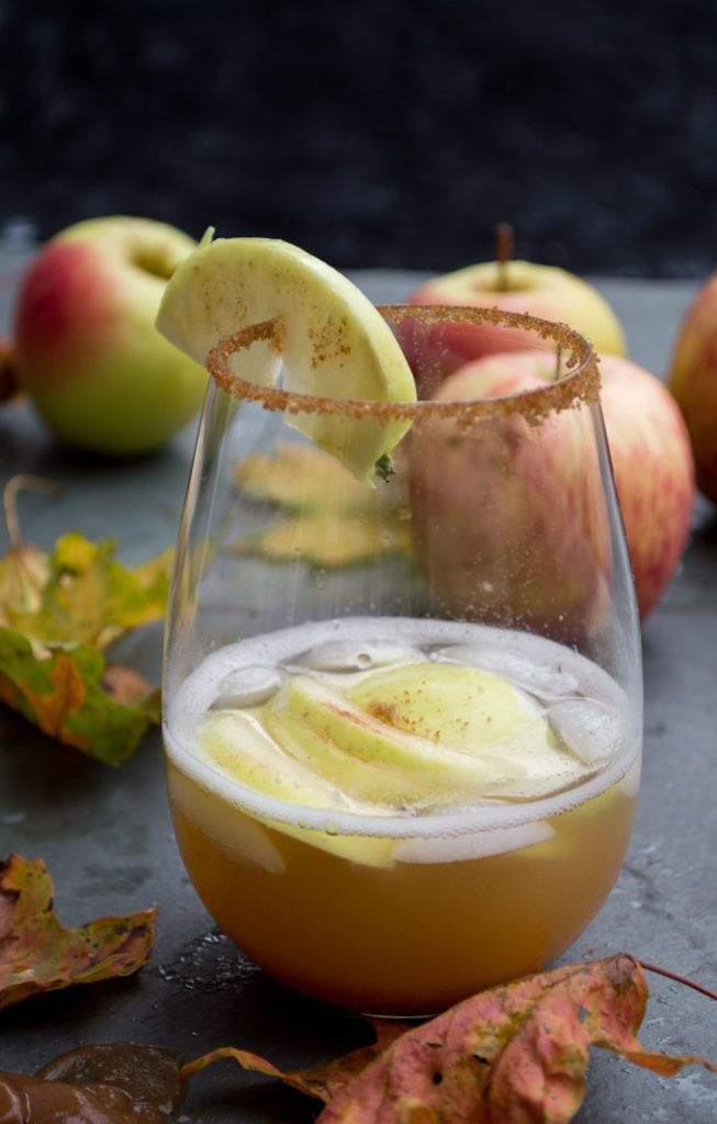 apple cocktail in a glass with apples