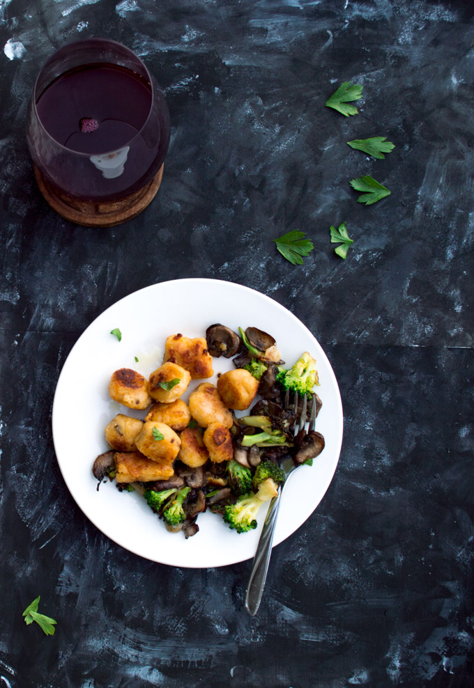serving butternut gnocchi with fall vegetables and wine