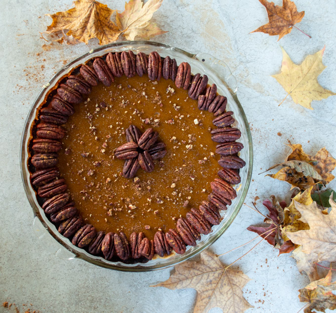 acorn squash pie with bourbon pecans and fall leaves