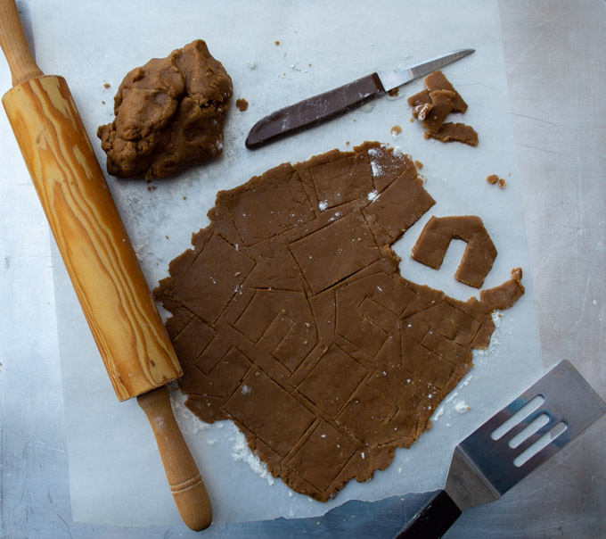 cutting out mini gingerbread houses