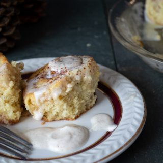 serving eggnog cinnamon rolls with frosting