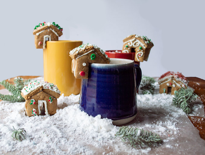 mini gingerbread house on mug with cocoa