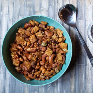 chili snack mix in a blue bowl