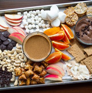 dessert board with treats, chocolate yogurt dip, and peanut butter dip