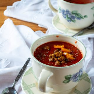 tomato soup with crispy chickpeas in a flower soup bowl