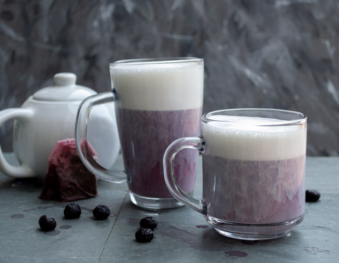 milk settled on top of blueberry earl grey tea