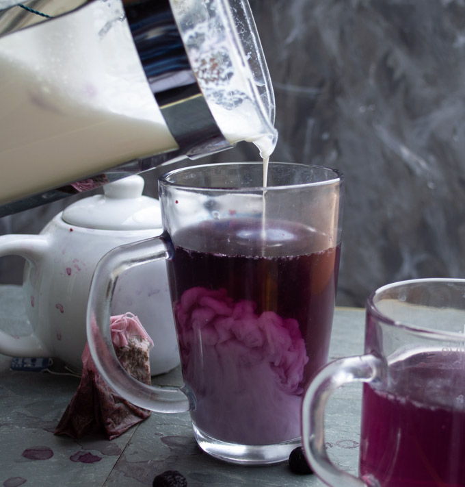 pouring milk into blueberry earl grey tea