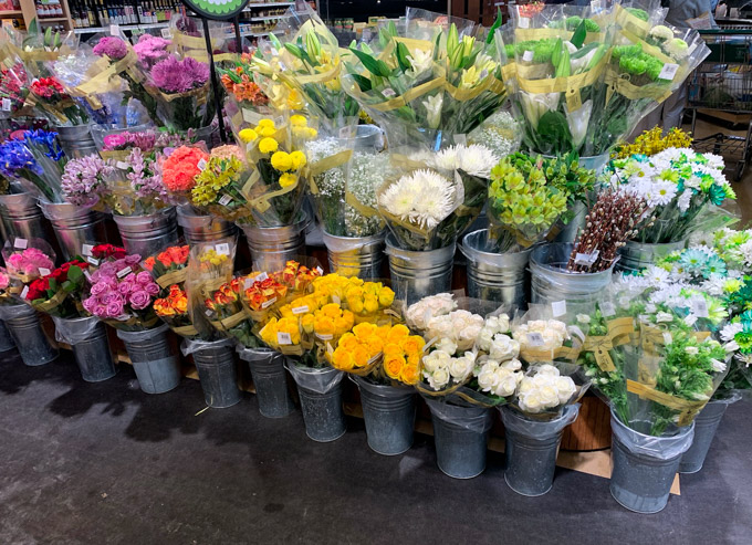 rainbow colors of flowers at the grocery store
