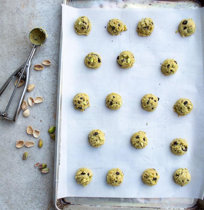 pistachio cookie dough on baking sheet