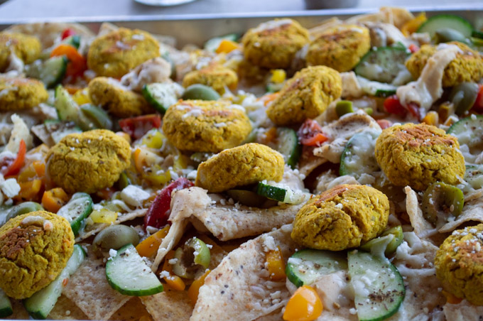 nachos with falafel, hummus, and vegetables