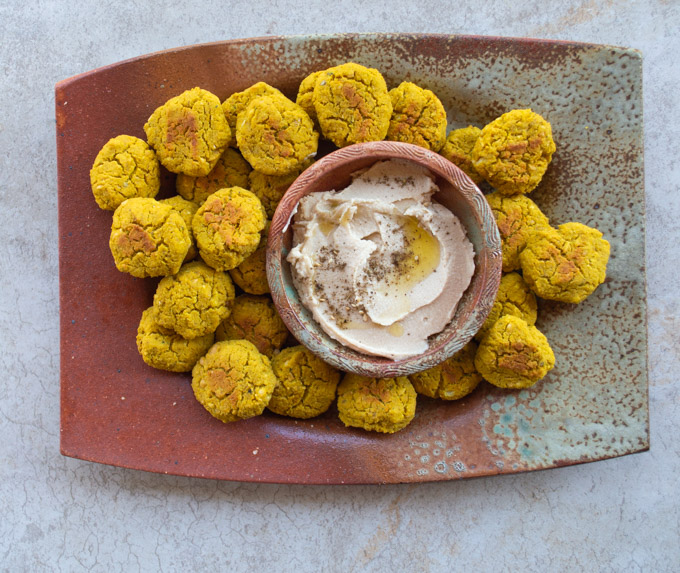 platter of falafel patties with hummus