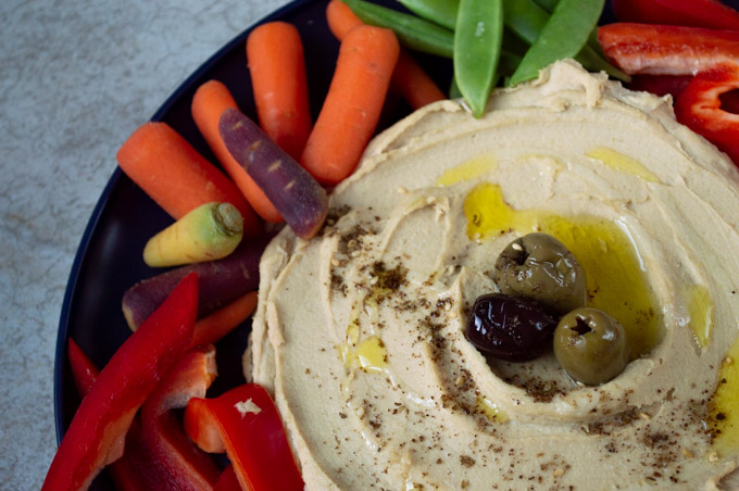 hummus with olives and raw vegetables