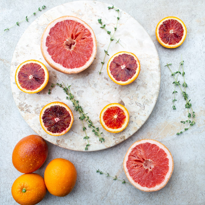sliced blood oranges and grapefruit with thyme