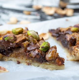 side view of baked and sliced pistachio pie