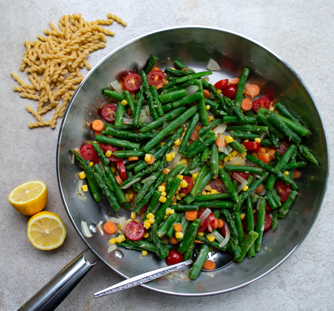cooked spring vegetables in a skillet