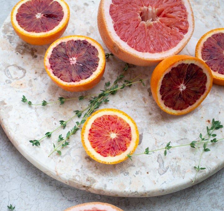 sliced oranges and grapefruit