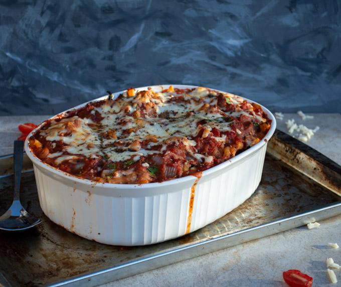 baked ziti in a white casserole dish