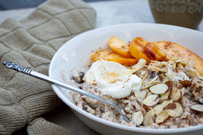 peach muesli with peaches, yogurt, and almonds